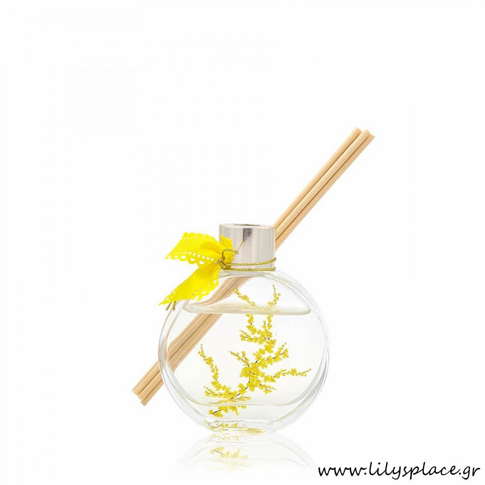 Aρωματικό χώρου με κίτρινα λουλούδια