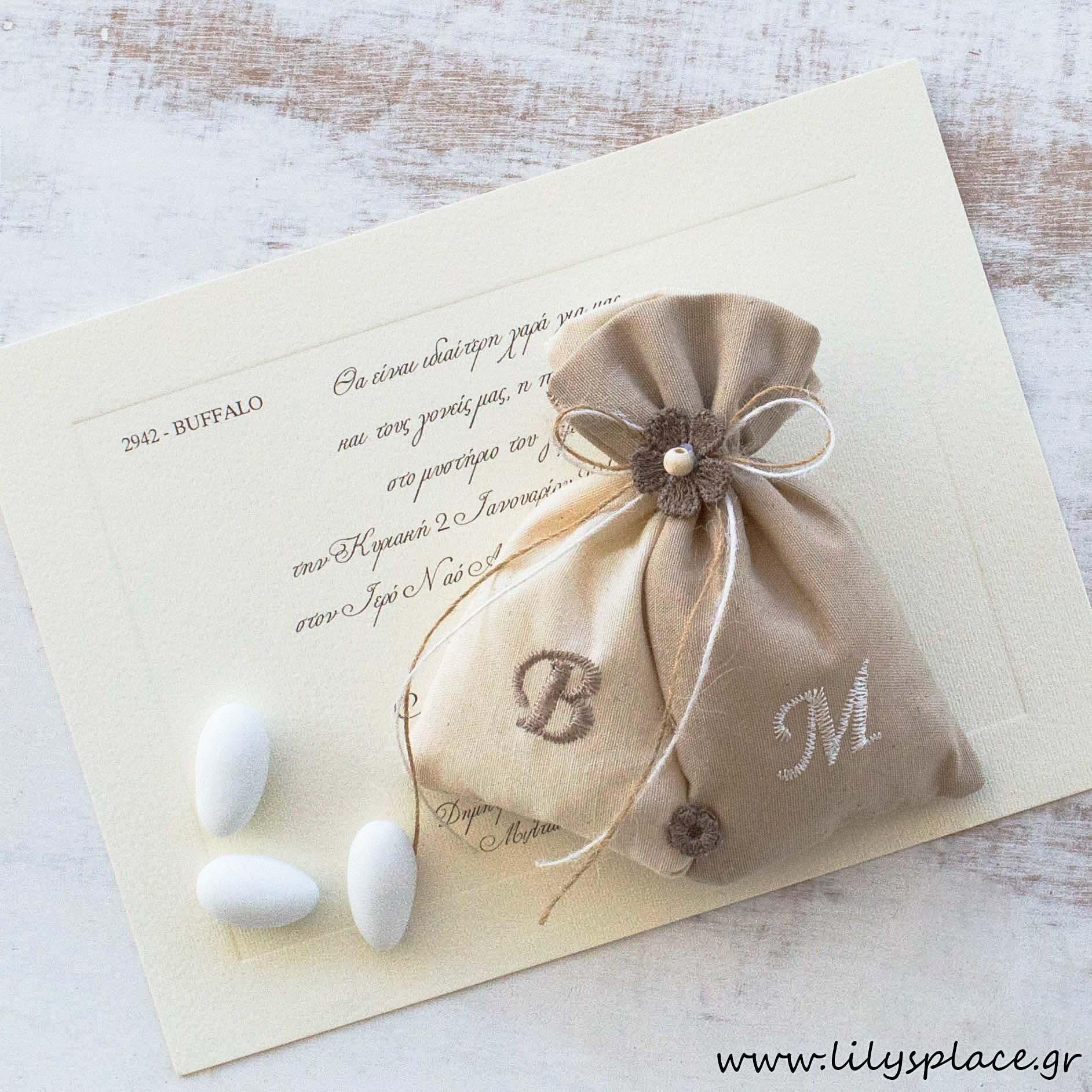Μπομπονιέρα γάμου πουγκάκια με μονογράμματα