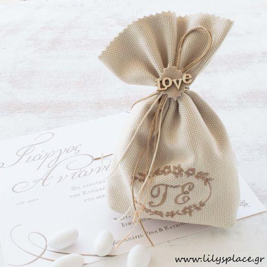 Μπομπονιέρα γάμου πουγκί με μονογράμματα